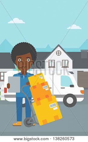 An african-american delivery woman with cardboard boxes on troley. Delivery woman with clipboard. Woman standing in front of delivery van. Vector flat design illustration. Vertical layout.