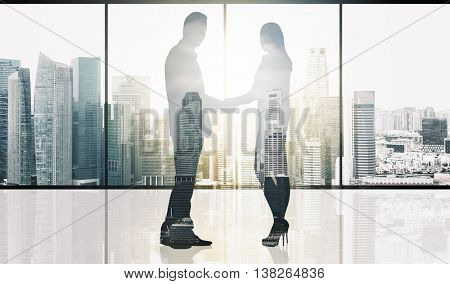 business, teamwork, partnership, cooperation and people concept - partners shaking hands over office window and singapore city skyscrapers background and sun light double exposure effect