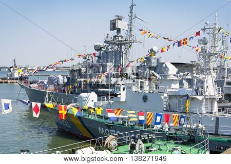 Odesa, Ukraine - July 10, 2016: Battleship HETMAN SAHAYDACHNY and other ships docked at Port of Odesa during celebration day of NAVY forces