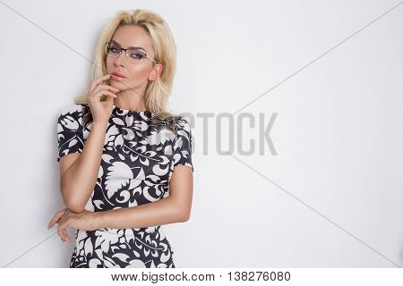 Beautiful Lush Blond Curly Hair Sexy Model With Green Eyes In Glasses In The Whit Black Elegant Shor