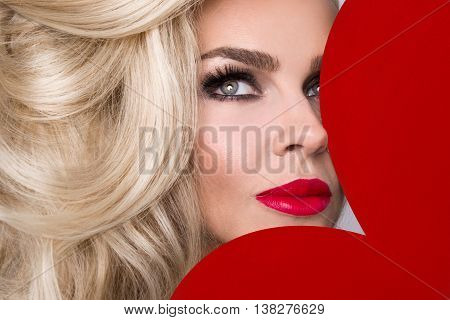 Beautiful Blond Sexy Women Model Girl In Love Valentine's Day With A Red Big Heart To Her Face And R