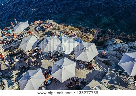 Dubrovnik Croatia - August 26 2015. People sits in restaurant under the Old Town Walls of Dubrovnik