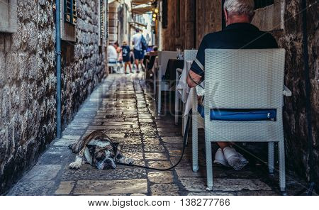 Dubrovnik Croatia - August 26 2015. Man sits in small restaurant on the Old Town of Dubrovnik