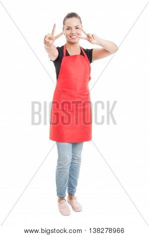 Young Hypermarket Saleswoman Doing Double Peace Gesture