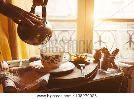 Morning tea with vintage tea props with sunlight