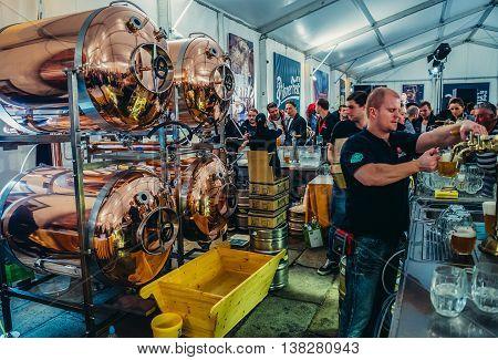Pilsen Czech Republic - October 3 2015. Bartender pours beer during Pilsen Fest in tent located in Pilsner Urquell Brewery area