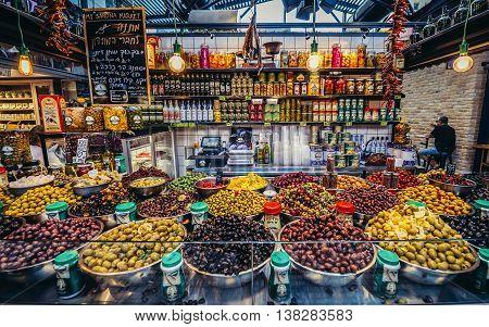 Tel Aviv Israel - October 21 2015. Olives for sale at pupular covered public market called Sarona Market in Tel Aviv