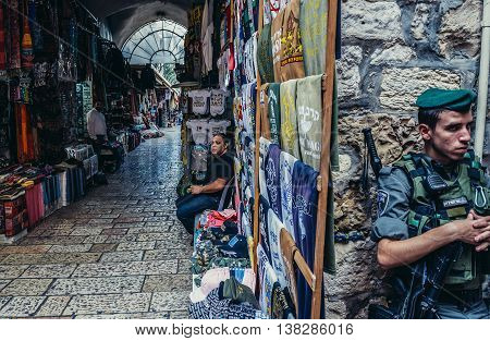 Jerusalem Israel - October 22 2015. Officer of Israeli Border Police called Magav on Arab baazar located inside the walls of the Old City of Jerusalem