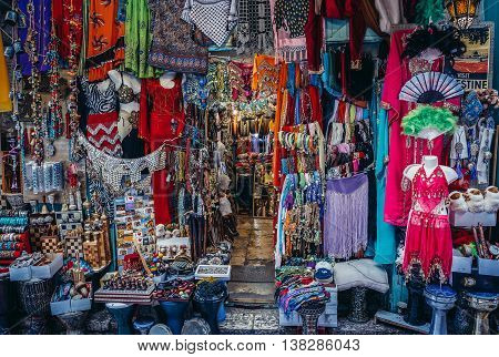 Jerusalem Israel - October 22 2015. Clothes scarfs and souvenirs for sale on Arab baazar located inside the walls of the Old City of Jerusalem