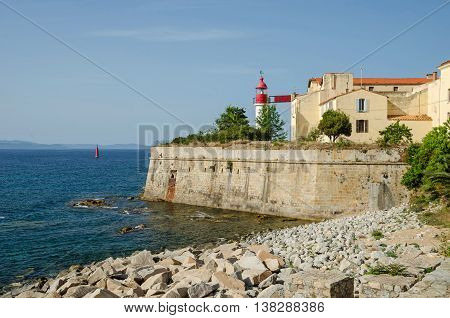 Ajaccio France - May 27 2016: the lighthouse of the citadel overlooking the bay in the center of capital city of Corsica and birthplace of Napoleon Bonaparte
