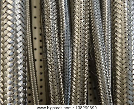 Detail photo texture of the braided high pressure hoses poster