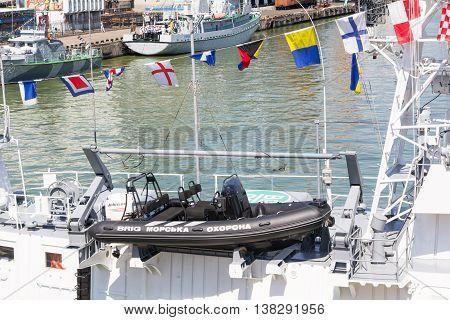 Odesa, Ukraine - July 03, 2016: Dinghy for the purposes of landing and patrol. The inscription on the boat 'sea guard'. Celebration of Ukrainian NAVY forces day