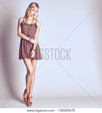 Hippie Boho woman Having Fun. Playful positive Model, Summer Fashion Outfit. Happy Blonde in Trendy Sundress, long hair, ethnic Fashion Accessories. Boho romantic fashion Style. Unusual creative look