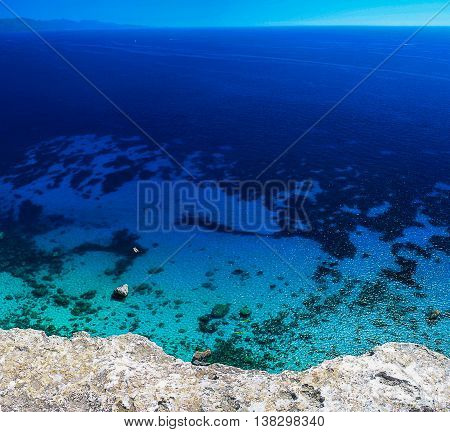 View from above on the Golf of Cagliari with the transparent sea water and the sea floor. Location is called La Sella del Diavolo - The Devil's Saddle closed to Cagliari Sardinia Italy.