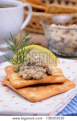 Appetizer of fish paste (forshmak) on crackers close up
