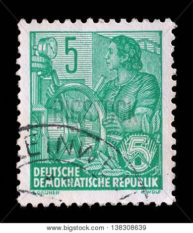 ZAGREB, CROATIA - SEPTEMBER 05: A stamp printed in GDR (German Democratic Republic - East Germany) shows a Woman at wheel switch, circa 1953, on September 05, 2014, Zagreb, Croatia