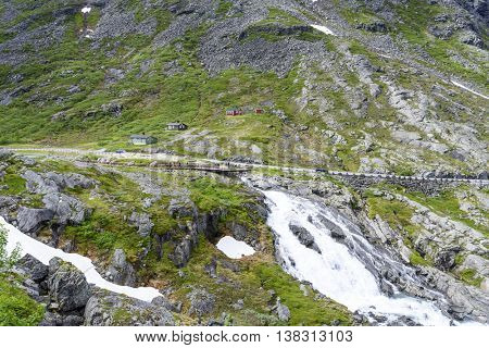 Between ANDALSNES and VALLDAL, NORWAY - JUNE 29: Tourists on a viewing platform near the Trollstigen road on June 29, 2016 between Andalsnes and Valldal, Norway.