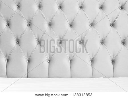 Soft Gray Headboard And White Bedding Sheets