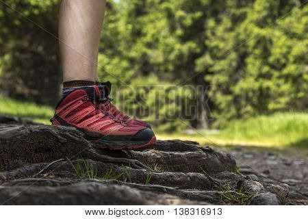 Woman is firmly standing on a rough terrain.