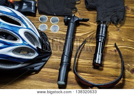 Items replacements and tools for a safe cycling: Helmet gloves glasses pumps patches tire chain tool. Tools and accessories set for cycling
