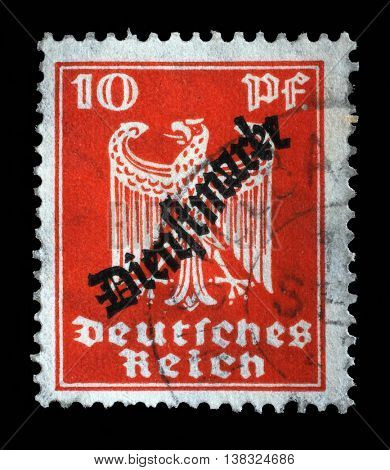 ZAGREB, CROATIA - JUNE 22: A stamp printed in the German Empire shows coat of arms of Germany, circa 1924, on June 22, 2014, Zagreb, Croatia