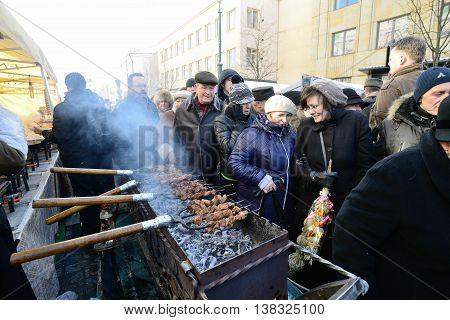 VILNIUS, LITHUANIA - MARCH 2: Unidentified people trades food in annual traditional crafts fair - Kaziuko fair on Mar 2, 2013 in Vilnius, Lithuania