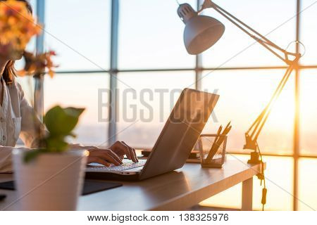 Adult businesswoman working at home using computer, studying business ideas on a pc screen on-line