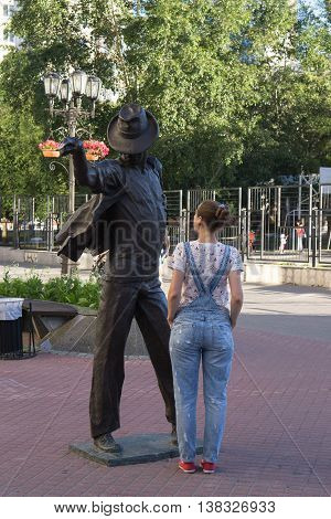 Yekaterinburg, Russia - July 10, 2016: The girl next to the statue of Michael Jackson street Weiner.