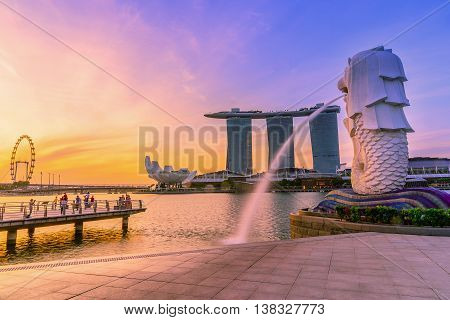 SINGAPORE-JULY 9, 2016: Merlion statue fountain in Merlion Park and Singapore city skyline at sunrise on July 9, 2016. Merlion fountain is one of the most famous tourist attraction in Singapore.