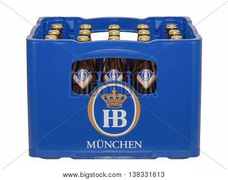 Munich Germany - June 10 2016: Isolated on white crate with bottles of classic German traditional Bavarian beer HB Munich