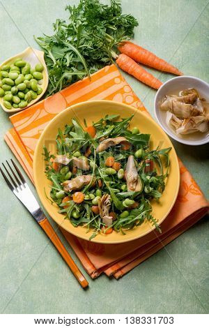 mixed salad with edamame arugula carrot and artichoke