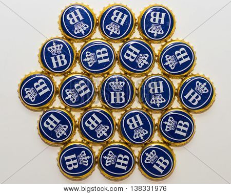 Munich Germany - June 10 2016: Many bottle caps of beer from Bavarian brewery Hofbrau Munich