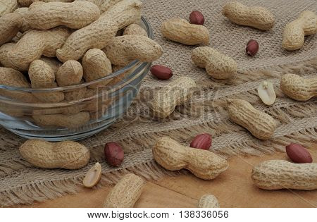 peanuts in a glass bowl and on the table
