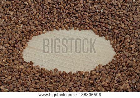 wheel with buckwheat on a wooden board