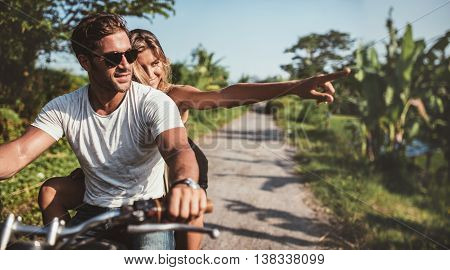 Beautiful Young Couple Riding Motorbike