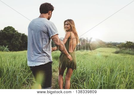 Young Couple Walking Along Country Path