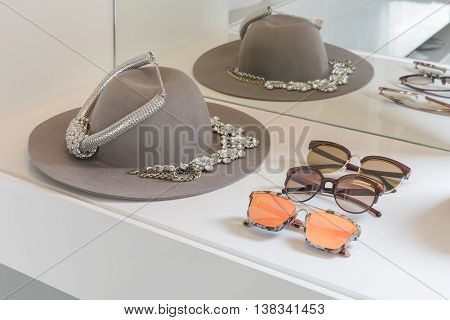 Female Accessories On White Dressing Table