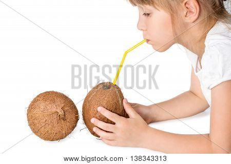 Girl holding a coconut and drank water from it through a straw isolated on white background