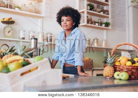 Attractive Young Woman Standing At Juice Bar Counter