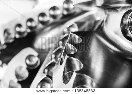 The drill bit, shot close-up with shallow depth of field. Industrial background. poster