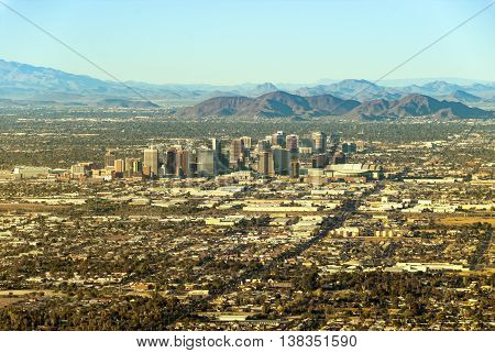 Downtown Phoenix Arizona with surrounding area seen from south-east during the day.