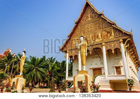 Vientiane Laos - March 16 2013: Golden Buddha statues & Buddhist temple Wat That Luang Neua in capital of Laos
