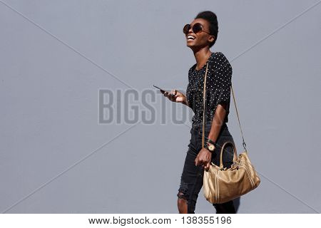 Stylish Woman Walking With Bag And Mobile Phone