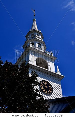 Fitzwilliam New Hampshire - July 11 2013: 1775 Original Meeting House with its wooden tiered steeple and-clock
