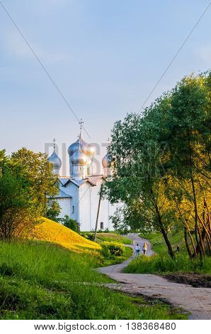 VELIKY NOVGOROD RUSSIA - JUNE 21 2016. Architecture landscape - church of the Saint Boris and Saint Gleb in Plotniki at summer sunset evening in Veliky Novgorod Russia