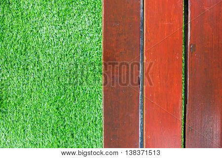 Abstract wooden background with turf grass background