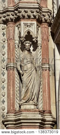 Fortitude virtue allegoric statue from Porta della Carta gothic gate in Saint Mark Square
