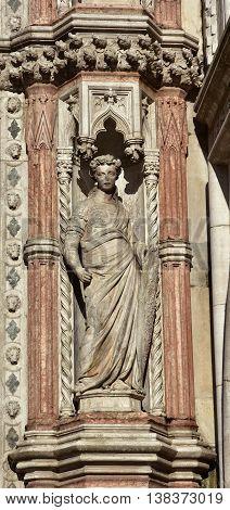 Fortitude virtue allegoric statue from Porta della Carta gothic gate in Saint Mark Square