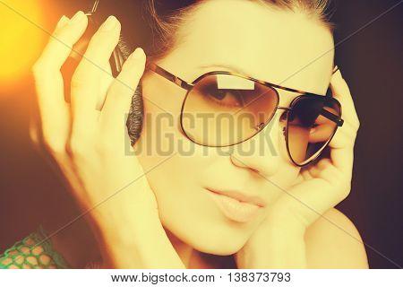Beautiful woman listening to headphones music