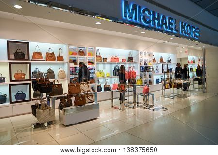 NEW YORK - APRIL 06, 2016: Michael Kors store in JFK Airport. Michael Kors Holdings is an American luxury fashion company established in 1981 by designer Michael Kors.